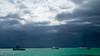clear water, dark sky (tattie62) Tags: travel sea tourism water weather boats catamaran mauritius