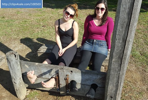 locked in the stocks pillory in tights and bare feet