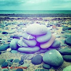 Pebble Pile (Viveca Koh FRPS) Tags: sea sky beach island pebbles pile pebblebeach ayres isleofman manx iphone iphoneography instagram