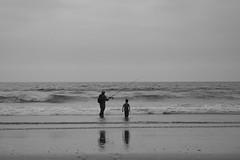 El nino y el pescador (CURZU@) Tags: chile bw blancoynegro sol monocromo coquimbo mar agua nubes pacifico oceano sudamerica rayos laserena cuartaregin airelibre