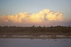 Puffy Cloud (Schwaco) Tags: ocean sunset red orange cloud sun hot beach gulfofmexico water sunshine clouds coast sand warm florida warmth shore orangesky redsky puffy cloudscape cloudporn puffyclouds naplesflorida naplesfl