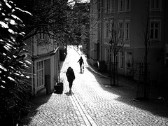 Winter sun (halifaxlight) Tags: street city trees urban norway buildings walking downtown shadows silhouettes sunny cobblestones bergen figures