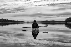 Kayaking (jarnasen) Tags: sky blackandwhite bw copyright lake nature water monochrome reflections mono kayak sweden outdoor canoe kayaking handheld sverige linkping kajak landskap svartvit stergtland pocketcam kindakanal lx100 rlngen panasonicdmclx100 wwwfacebookcomjarnasenphotography