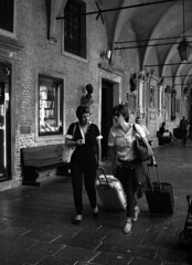 Trolleys (r_evolution63) Tags: street city people urban bw italy woman church monochrome sanantonio grey monocromo blackwhite donna ancient women europa europe strada italia grigio gente cathedral basilica sony streetphotography streetlife tourists bn persone chiesa donne cloister persons antonio antico bianconero santo pilgrim compact chiostro turisti santantonio citt padova pilgrims padua veneto pellegrine dscw7 turiste basilicadisantantonio pellegrina provinciadipadova