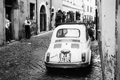 Feels like another decade     Rome, Spring 2016 ({ sara }) Tags: street old travel blackandwhite italy rome roma car vintage women europe italia fiat trastevere cobblestones 500 waitress timeless
