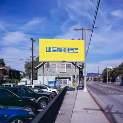 billboard. venice beach, ca. 2016. (eyetwist) Tags: california street venice 120 6x6 mamiya film beach sign yellow analog mediumformat square typography 50mm la losangeles los saturated parkinglot fuji angeles slide icon ishootfilm billboard boring sidewalk powerlines velvia socal chrome wires transparency type venicebeach 100 lettering analogue mamiya6 e6 blight brooks banal typographic emulsion rvp primes f4l angeleno fujivelvia100rvp eyetwist 6mf mamiya6mf siliconbeach epsonv750pro recentlyprocessedfilm filmexif filmtagger eyetwistkevinballuff mamiya50mmf4l transparencye6 snapchat