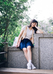 Hidy (I C E I N N) Tags: blue trees portrait people white girl smile leaves yellow metal stone wall asian 50mm grey blurry dof photoshoot bokeh outdoor sony gray navy tshirt skirt e sneaker vest fe   speedmaster gaze trainer waistcoat creamy pleated f095  zhongyi hidy headrail mitakon  sonya7ii ilce7m2