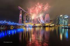 TeamCap's Light (LemjayLucas) Tags: city longexposure singapore fireworks cityscapes sg captainamerica nightscapes marinabay helixbridge marinabaysands teamcap lemjaylucas lemjaylucasphotography teamironman lemjaylucastravels lemjaylucasnightscapes
