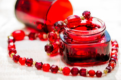 A Study in Scarlet (coffeego) Tags: light red macro glass scarlet beads jewelry jar astudyinscarlet