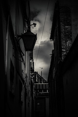 Gloomy Streets of Yarmouth (Lauren Peace Photography) Tags: street old uk light england blackandwhite cold brick wet rain clouds dark outside outdoors coast alley nikon gloomy norfolk victorian windy rainy tones greatyarmouth d3100
