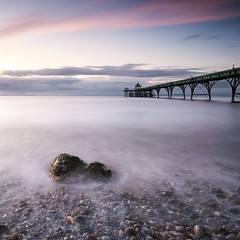 Pebbles, Rock and the Pier (~g@ry~ (clevedon-clarks)) Tags: uk longexposure sunset seascape clouds bench landscape coast pier rocks victorian somerset pebbles coastal clevedon northsomerset clevedonpier milkywater victorianpier 10stopnd hitechfilters mistyrocks mistypebbles