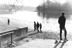 (Adrian Alexe) Tags: park street trees people blackandwhite sun white lake playing man black tree water monochrome silhouette kids children photography kid rocks day child outdoor mother scooter shade romania moment bucharest bucuresti decisive roumania