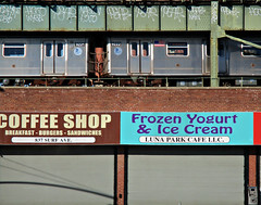Passing Train Above Cafe (Robert S. Photography) Tags: street nyc winter signs coffee brooklyn train canon buildings subway gates powershot icecream shops passing elevated irt cafes 2016 iso125