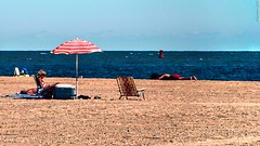 Take the day off!... (a2roland) Tags: ocean new city blue sleeping sea woman holiday beach umbrella lens relax landscape reading photo office sand nikon picnic flickr day waves zoom relaxing nj picture sunny scene spot off calm atlantic norman shore jersey waters serene char recliner buoy seas flicker boon 135mm zeb d80 a2roland a2rolandyahoocom normanzeb