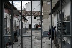 A door to the past // Puerta al pasado (katalan46) Tags: madrid street door old espaa house metal casa spain puerta pass viejo antiguo pasado