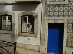 Whats Happening? (ManOfYorkshire) Tags: street door old houses portugal window lady fence looking lisbon number tiles 40 checking 38