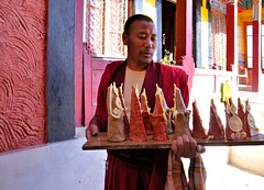 Thiksay Monastery..... Candid Moments (pallab seth) Tags: city travel panorama india mountain tourism statue landscape asia tour traditional culture monk monastery valley idol lama layers lamps custom leh himalayas deity thikse highaltitude gompa butterlamps buddhistmonk tibetanbuddhism jammuandkashmir spiritualleader indusvalley thiksay thikseygompa