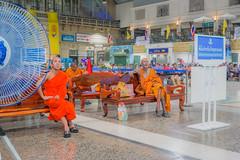 Monks waiting for the train (juhududa) Tags: city light orange station night thailand hall waiting colorful asia bangkok south samsung railway monk east monks wait hua patience lamphong nx300