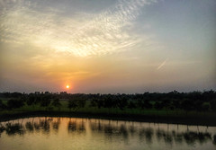 the last kiss (nayem.romiz) Tags: sunset sun water landscape dawn evening pond reflaction