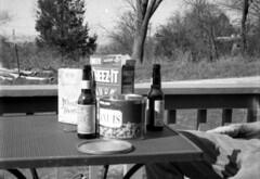 still life (bergytone) Tags: bw food film beach beer analog picnic minolta stock peanuts miller gary snacks 16mm ilford fp4 munchies xtol in wheatthins subminiature minolta16 cheezeit