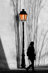 a light on your way (Wackelaugen) Tags: street light shadow blackandwhite bw woman white black france sc girl silhouette wall canon easter walking photography eos mono photo blackwhite colmar lantern googlies happyeaster selectivecoloring persin wackelaugen