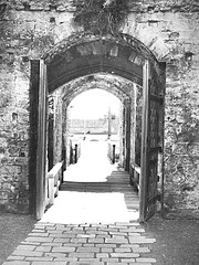Gateway to the past (CMF1983) Tags: blackandwhite bw castle history stone hampshire medieval gateway portsmouth drawbridge portchester englishheritage