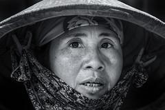 Eye-shaped portrait (Axel Halbgebauer) Tags: street travel portrait blackandwhite bw face hat zeiss asia candid sony ngc headshot vietnam fe hanoi 135mm flickrtravelaward