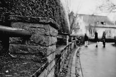 Blurred people (Leica Minilux) (stefankamert) Tags: street leica blackandwhite bw snow film analog 35mm blackwhite dof bokeh grain blurred xp2 sw ilford minilux summarit schwarzweis stefankamert