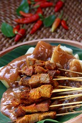 Satay Padang (Miel Photopgraphy) Tags: indonesia beef meat satay streetfood ricecake padang offal ketupat sate charred redsauce grilledfood pariaman westsumatra spicysauce thicksauce barbecuedfood