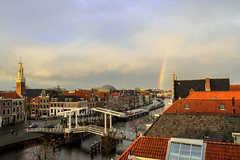 Spaarne - Haarlem, The Netherlands (Dutchflavour) Tags: city sunset holland church haarlem netherlands spaarne skyline river rainbow cityscape centre nederland citylandscape gravestenenbrug