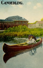 Canoedling (Alan Mays) Tags: old blue brown men green water vintage buildings reflections paper boats typography women kissing funny humorous comic antique humor illustrations kisses romance ephemera canoes postcards type streams amusing canoeing umbrellas fonts printed cuddling oblivious wordplay waterways oars typefaces parasols preoccupied canoodling canoedling