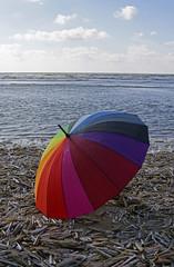 Umbrella at Sea. (Knoffelhuisie Photography.) Tags: sea color colour colors regenboog umbrella farbe paraplu kleur kleuren colourd