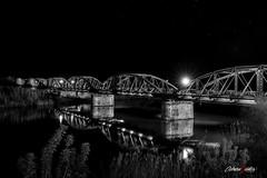 El puente de Hierro (adrivallekas) Tags: nightphotography bridge blackandwhite bw byn blancoynegro water rio night river stars puente lights noche agua bn ironbridge toledo estrellas nocturna talavera tajo reflejos reflects rotajo puentedehierro talaveradelareina fotografanocturna puentereinasofia