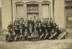 Hetton Colliery Silver Prize Band (Tyne & Wear Archives & Museums) Tags: door portrait music abstract building men industry window boys grass hat stone wall shirt musicians sepia architecture standing children shoe 1974 interesting fantastic unitedkingdom drum timber board coat debris decoration stripe band tie ground rope moustache cap frame signage button archives letter trousers unusual pocket striking seated crease attentive impressive brassband distracted fascinating digitalimage sunderland musicalinstruments citycouncil 1895 early20thcentury socialhistory blackandwhitephotograph northeastofengland artanddesign moorsley eastrainton hettonlehole hettonhall collieryband easingtonlane hettoncolliery hettonurbandistrictcouncil hettonleholeurbandistrict sunderlandmetropolitanborough localgovernmentact1894 hettoncollierysilverprizeband