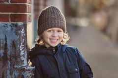 Gabriel (StefanieArcher) Tags: winter boy smile hat canon child outdoor teeth backlit 135mm 6d
