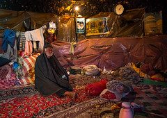 old man in his troglodyte house, Kerman province, Meymand, Iran (Eric Lafforgue) Tags: winter people house man cold men heritage tourism archaeology horizontal stone architecture underground carpet asia sitting village iran persia architectural historic unescoworldheritagesite indoors human cave adults residential ancientcivilization troglodyte thepast adultsonly cultural oneperson middleeastern traditionalculture rockformation menonly seniorman archaeologicalsite traveldestinations lookingatcamera  fulllenght onemanonly  touristdestination 1people  iro  builtstructure residentialstructure maymand meymand colourpicture humansettlement kermanprovince  irandsc07889