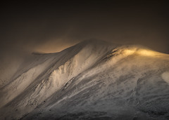 Slopes, Snow & Sunlight (Vemsteroo) Tags: morning winter light cloud mountain snow cold sunrise canon landscape foreboding exploring hill lakedistrict dramatic cumbria littleman 5d drama epic fell cloudscape skiddaw slopes 70200mm mountainscape mkiii circularpolariser visitengland leefilters visitbritain