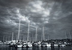 Dark Harbor (zuni48) Tags: blackandwhite monochrome weather wisconsin marina reflections boats harbor superior stormclouds zunikoff