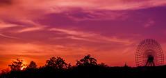 Loveland (Sara Maneiro Rey) Tags: pink santiago light sunset sky panorama orange silhouette clouds evening colorful purple compostela ferriswheel noria