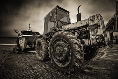 Rubber and Rust (Mister Electron) Tags: england blackandwhite bw tractor beach monochrome sepia boat blackwhite seaside rust marine moody decay wheels norfolk shingle oxidation toned lowkey tow corrosion ironoxide tyres eastanglia cromer electrochemistry nikond800