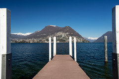 Lugano, Switzerland (petia.balabanova) Tags: travel blue sky lake water landscape switzerland ticino frame traveling svizzera lugano paesaggio montains pontile 1735mm nikond800
