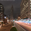 Flashy Flatiron (DSC04476) (Michael.Lee.Pics.NYC) Tags: longexposure newyork architecture night square cityscape sony fifthavenue flatironbuilding lighttrail traffictrail pedestrianplaza voigtlanderheliar15mmf45 a7rm2