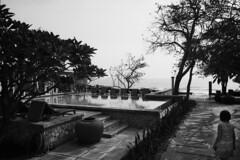 Hua-Hin, Thailand (jonasfj) Tags: morning trees woman film beach pool analog garden thailand hotel nikon dress 28mm 11 swimmingpool analogue huahin ilford fp4 f28 horizont fa ais crc nikonfa xtol ilfordfp4 filmphotography colonialstyle 10min 2828ais