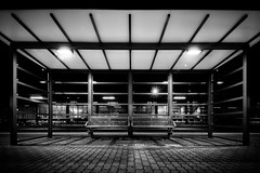 at the station x (Zesk MF) Tags: bw white black lines architecture night train dark bench nikon long sigma bank bahnhof seats 8mm bushalte trier nachts langzeitbelichtung wartehuschen zesk