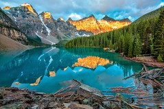 Moraine Lake Yellow Mountains (jeff Tani) Tags: morning trees plants lake canada reflection yellow sunrise rocks logs can canoe alberta banffnationalpark morainelake