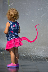 Prehensile Tail (swong95765) Tags: cute wet water fountain girl kid child tail young evolution skirt cutie evolve