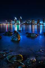 San Diego at night. (realbrimizer) Tags: ocean california city blue water skyline architecture night marina buildings reflections island lights pier san long exposure downtown waterfront skyscrapers bright outdoor smooth diego center convention hyatt coronado