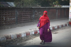 The cold wind blows (N A Y E E M) Tags: street morning red portrait woman raw candid hijab windshield unposed niqab yesterday untouched bangladesh burqa unedited chittagong sooc ornizamroad