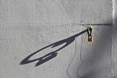 pulled the ring through the nose and  locked it_ (raumoberbayern) Tags: winter shadow abstract wall grey lock wand grau minimal schloss wasserburg streifen robbbilder urbanfragments schattten