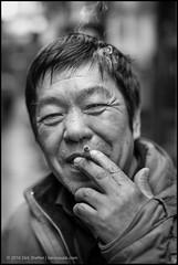 (teknopunk.com) Tags: china portrait people blackandwhite man cold asian eyecontact asia shanghai cigarette chinese streetportrait smoking rainy oneperson oneman leicammonochromsn4342460 50f14summiluxe46sn4010092blackpaint